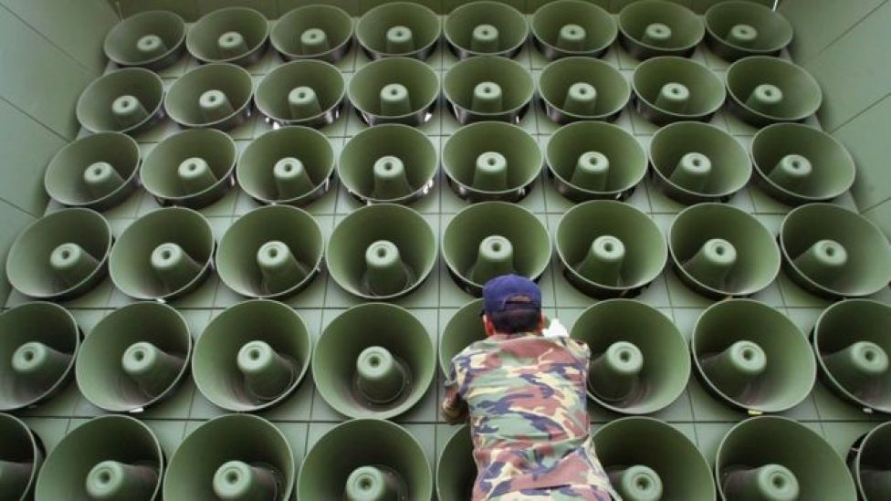 A South Korean soldier takes down a battery of propaganda loudspeakers on the border with North Korea in Paju on 16 June 2004
