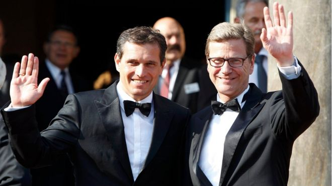 Guido Westerwelle and his partner Michael Mronz (L) arriving on the red carpet for the opening of the Bayreuth Wagner opera festival outside the Gruener Huegel (Green Hill) opera house in Bayreuth July 25, 2012.