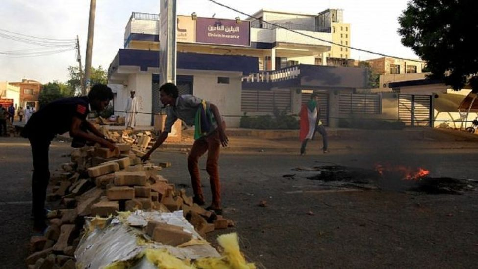 Protesters erect a barricade along a street during demonstrations in central Khartoum, Sudan May 15, 2019