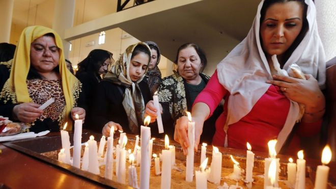 Assyrian Christians, who have fled the unrest in Syria and Iraq, at a church in Jdeideh, north-east of the Lebanese capital Beirut, on 8 March 2015
