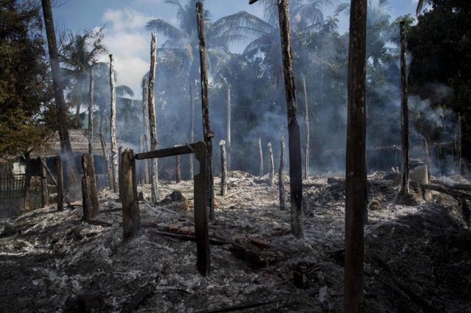 Smouldering debris of burned houses is seen in Warpait, a Muslim village in Maungdaw located in Myanmar's Rakhine State, 14 October