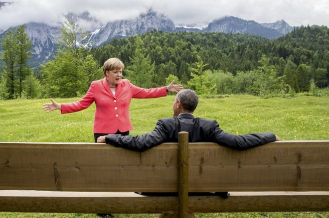 German Chancellor Angela Merkel speaks with US President Barack Obama outside the Elmau castle in Kruen near Garmisch-Partenkirchen, Germany