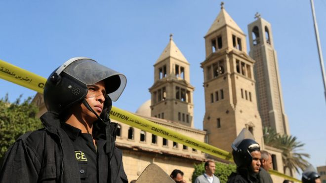 "Members of the special police forces stand guard to secure the area around St. Mark""s Coptic Orthodox Cathedral after an explosion inside the cathedral in Cairo"