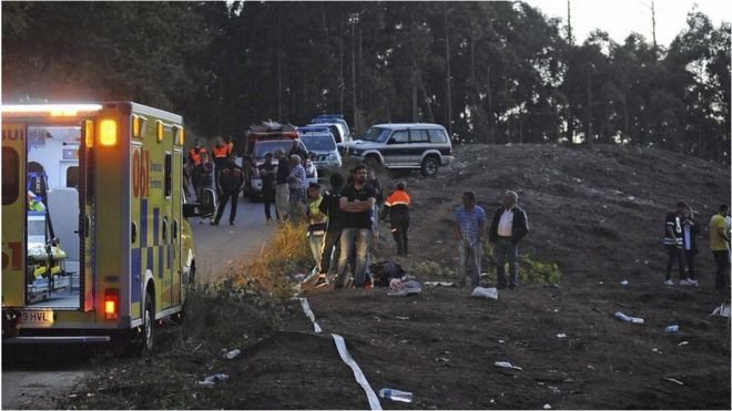 Spanish emergency personnel work at the scene of the accident