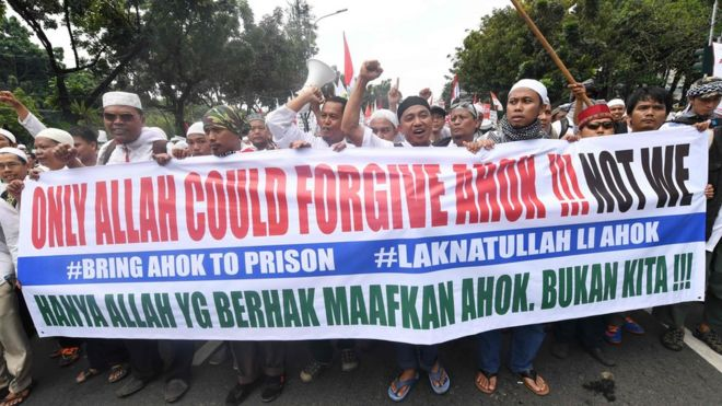 """Protesters carry a banner saying """"only Allah could forgive Ahok!!! Not we"""""""