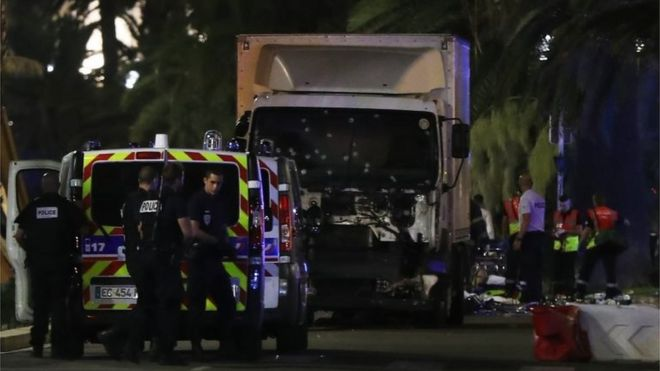 French police stand near the lorry that ploughed into crowds in Nice