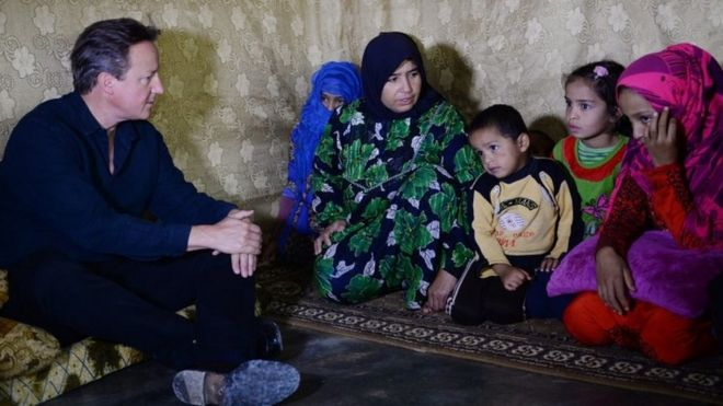 David Cameron meets Syrian refugee families at a tented settlement camp in the Bekaa Valley on the Syrian - Lebanese border