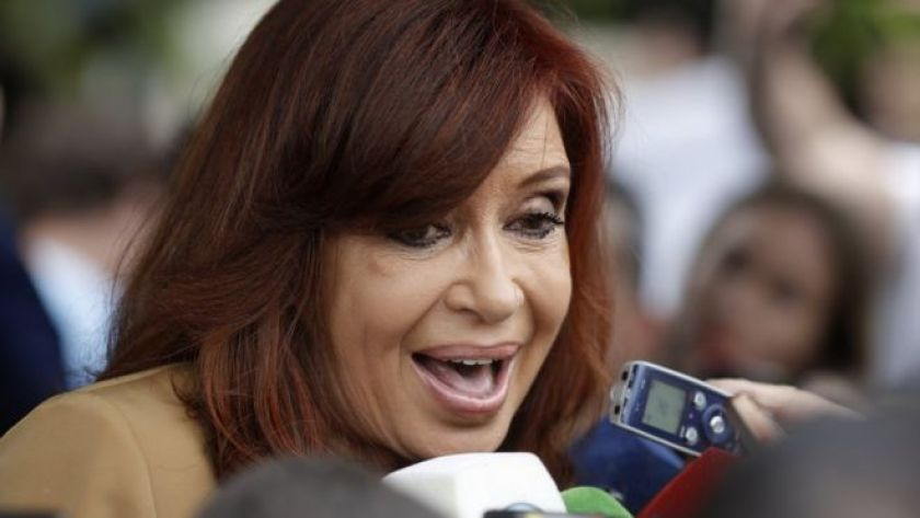 Cristina Fernandez speaks to journalists after appearing before a judge on a corruption case in Buenos Aires, Monday, Oct. 31, 2016