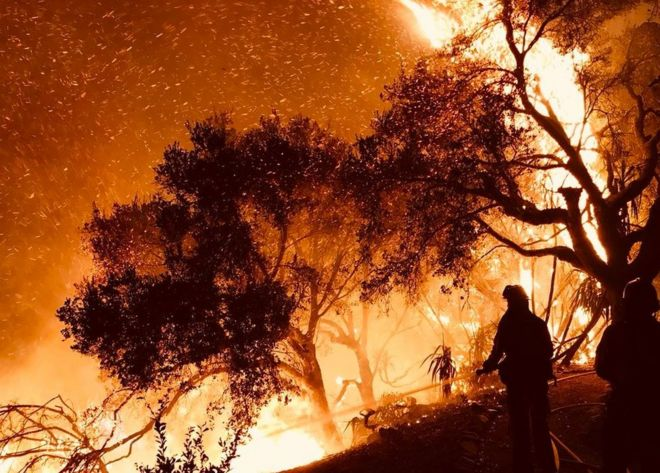 Firefighters knock down flames as they advance on homes in Carpinteria