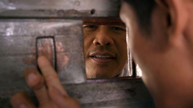 Ali Fauzi at a prison gate