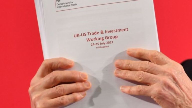 Jeremy Corbyn holds up the leaked documents