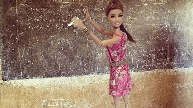 Barbie in front of a blackboard