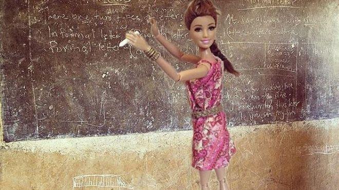 Barbie in front of a blackboard