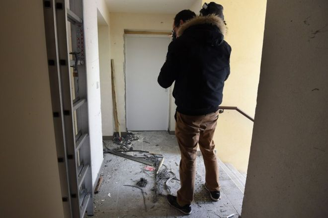 A journalist films debris outside the flat in Montpellier, 10 February