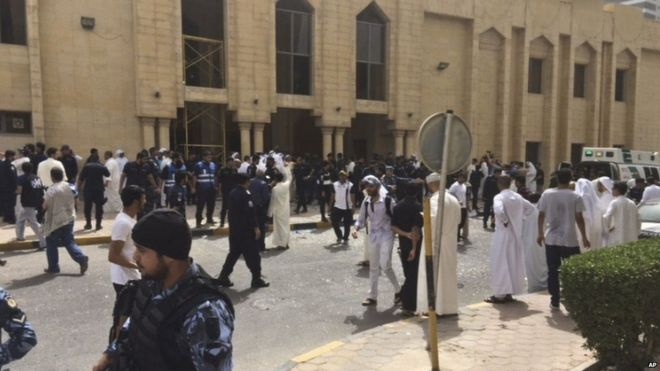 Security forces, officials and civilians gather outside of the Imam Sadiq Mosque after a deadly blast struck in Kuwait City on 26 June 2015.