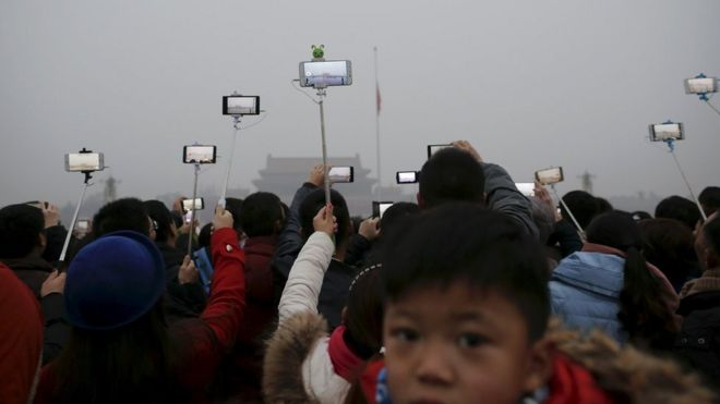 People held their mobile phone cameras aloft