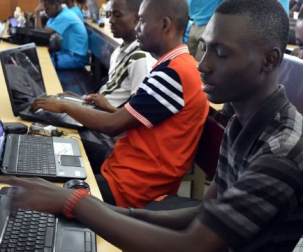 People attend a computer training course, as part of the 'Afrique Innovation, reinventer les medias