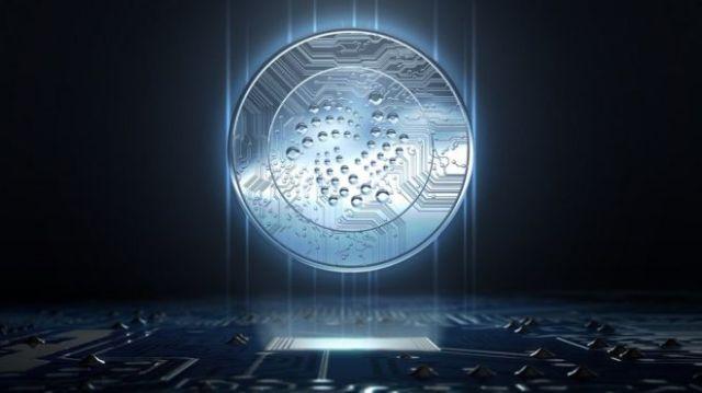 Ilustração usando uma moeda do IOTA