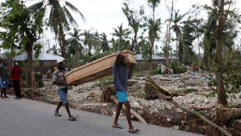 Men carry a coffin after Hurricane Matthew hit Cavaillon, Haiti