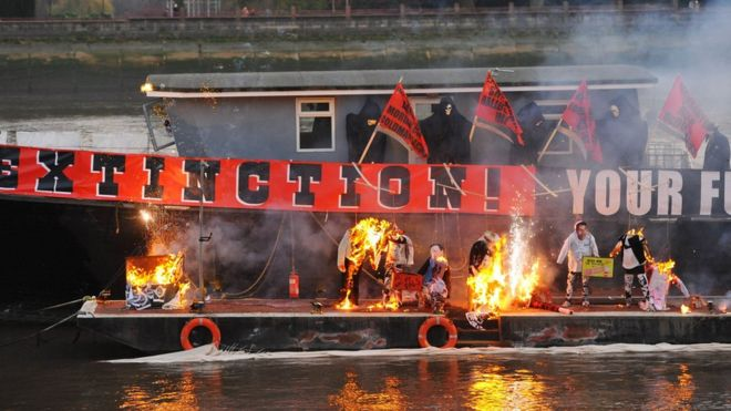 Joe Corre burns his £5 million punk collection on a boat on the River Thames in London.