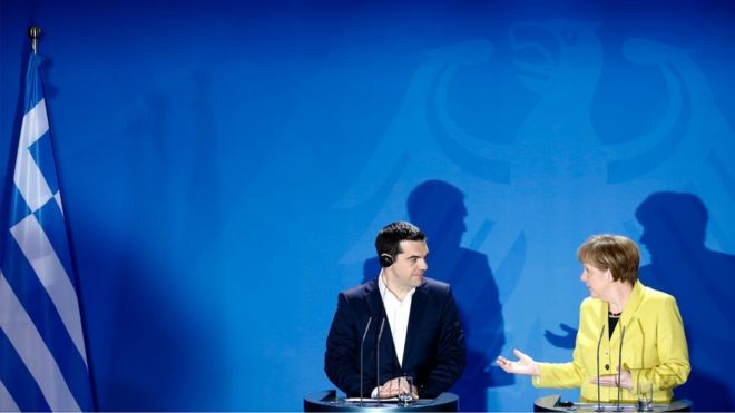 Chancellor Angela Merkel, right, and the Prime Minister of Greece Alexis Tsipras brief the media during a bilateral meeting at the chancellery in Berlin.
