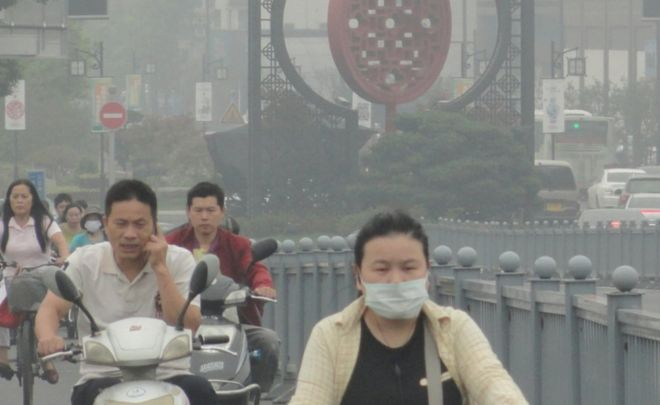 People cycling, some in face masks, in Jiangsu Province