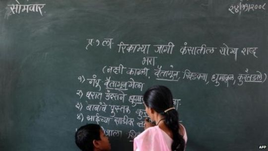 Why is Sanskrit so controversial    BBC News Hindi script on a blackboard in a classroom in India