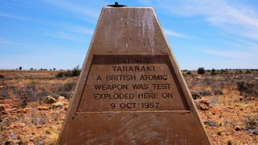 A sign marking the explosion stands in the test site