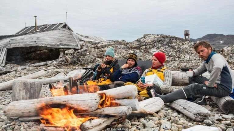 A driftwood bonfire on a lonely beach in northwest Svalbard