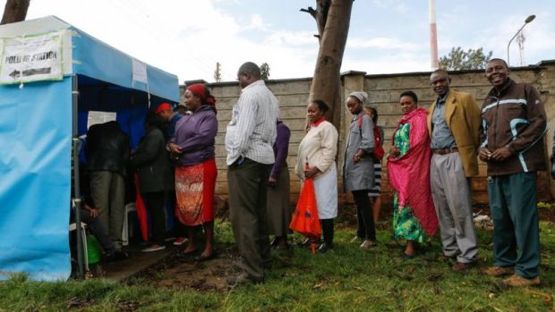 Kenyan voters queue as they wait to cast their votes in Huruma, one of the ruling party Jubilee
