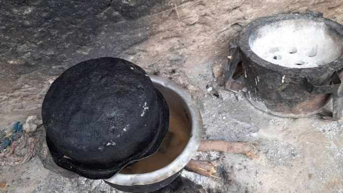 Cooking pots belonging to Peninah Bahati Kitsao in Mombasa, Kenya