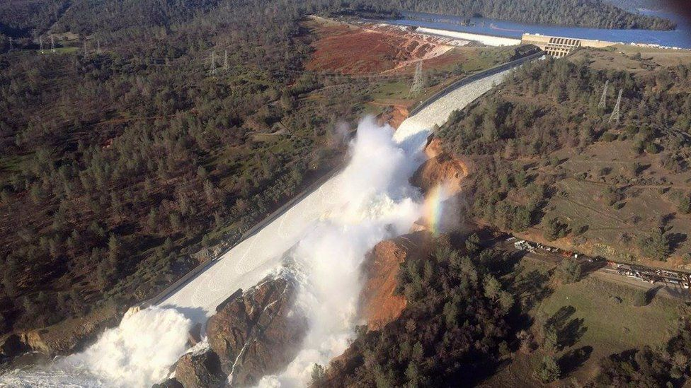 The damaged spillway and the eroded hillside at the Oroville Dam