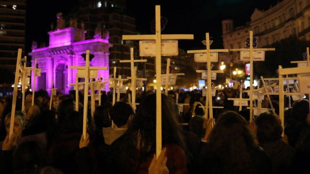 People attend a march marking the International Day for the Elimination of Violence against Women in Valencia, Spain, 25 November 2019.