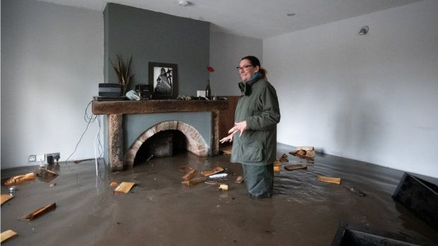 Gabrielle Burns-Smith at her flooded home in Lymm, Cheshire