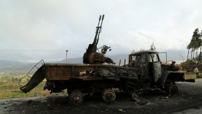 """A machine gun mounted in a burnt-out truck on the road to Abiy Addi town in Ethiopia, July 10, 2021. The area saw fierce fighting between Ethiopia""""s military and Tigrayan forces"""