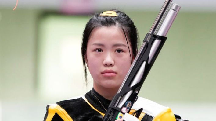 Yang Qian of China celebrates after winning the 10m Air Rifle Women's Final on the first day of the Tokyo 2020 Olympic Games