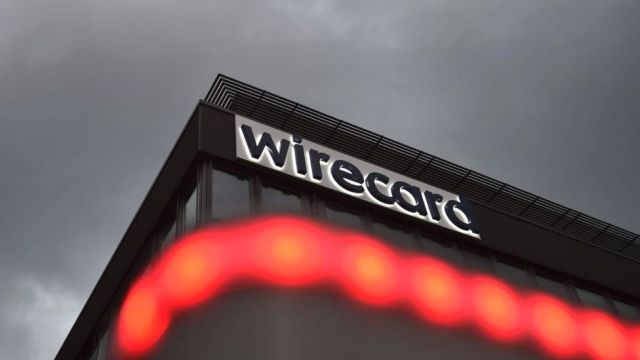The logo of German payments provider Wirecard is seen at a building of the company's headquarters in Aschheim near Munich, southern Germany, on September 2, 2020
