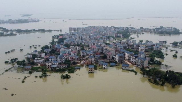 This aerial photo taken on 16 July 2020 shows a flooded area near the Poyang Lake due to torrential rains in Poyang county, Shangrao city, in China's central Jiangxi province