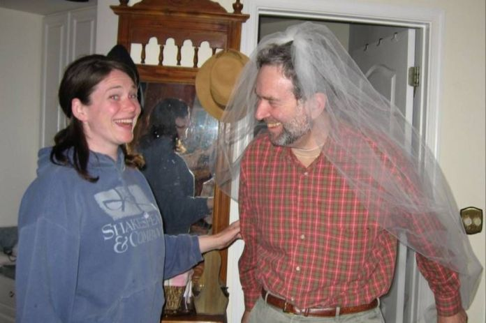Sara Faith Alterman and her father Ira wearing a wedding veil