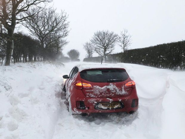 Handout photo of a car stuck in the snow at Southrepps in Norfolk, on 8 February 2021