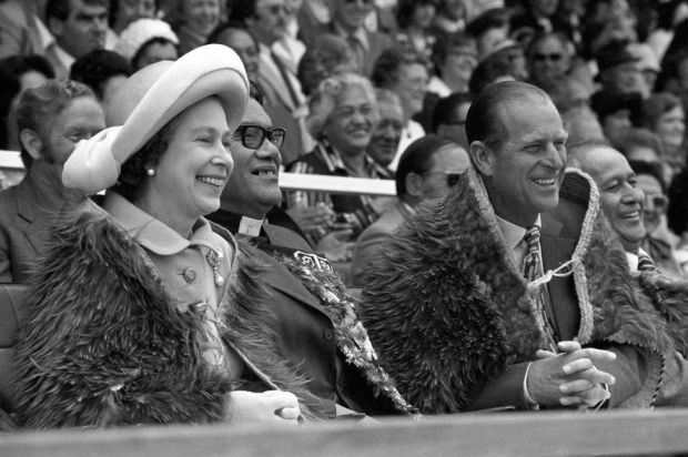The Queen and the Duke of Edinburgh, both wearing Maori Kahu-Kiwi (Kiwi feather cloaks) at Rugby Park in Gisborne, on the North Island of New Zealand when they attended the opening of the Royal New Zealand Polynesian Festival as their Silver Jubilee Tour continues
