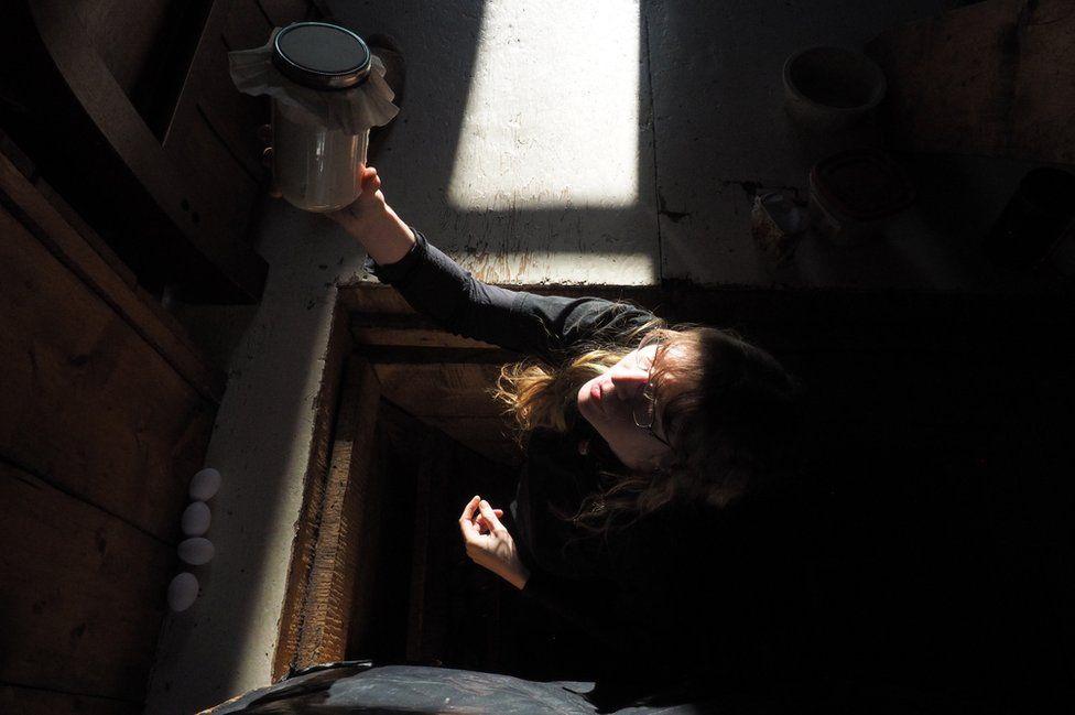 Romey reaches for a jar
