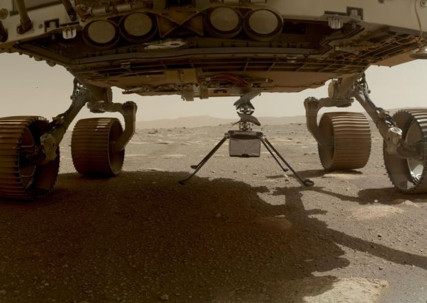 Nasa's Ingenuity helicopter can be seen with all four of its legs deployed below the Perseverance rover, on 30 March 2021