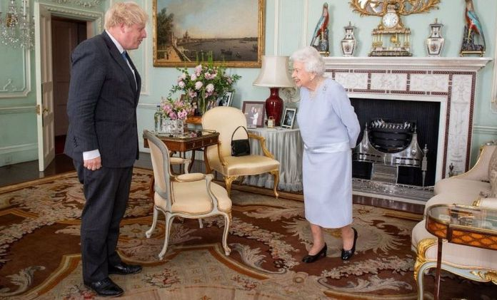 The prime minister meeting the Queen at Buckingham Palace