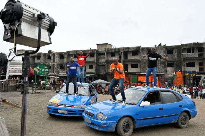 Members of Magic System being filmed in the Anoumabo neighbourhood of Abidjan, Ivory Coast - Sunday 8 August 2021