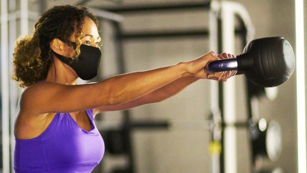 Woman at gym in a facemask