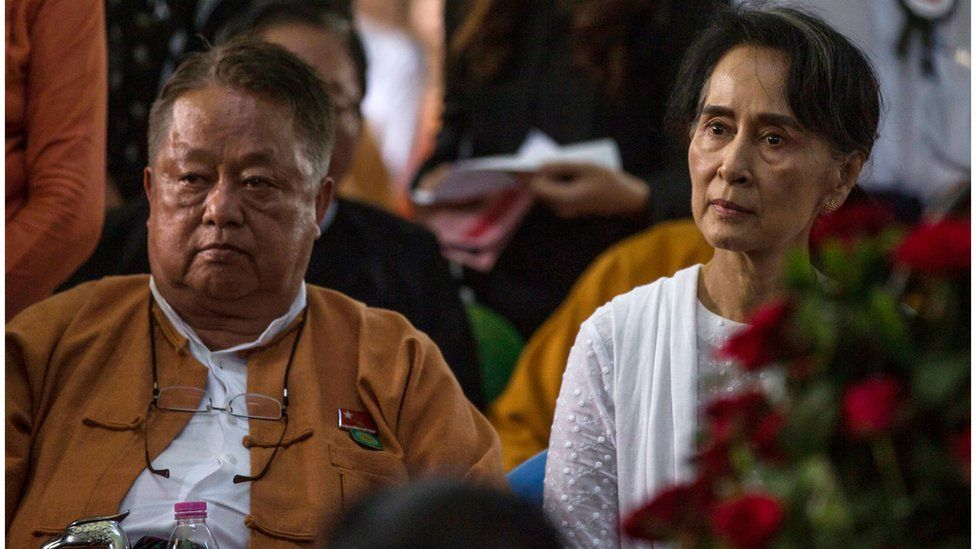 Myanmar's State Counselor Aung San Suu Kyi (R) and Win Htein, chief executive committee members of the National League for Democracy (NLD), attend the funeral service for the party's former chairman Aung Shwe in Yangon on August 17, 2017.