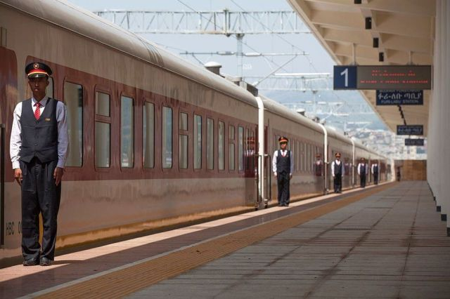 Chinese employees of the Addis Ababa / Djibouti train line stand at the Feri train station in Addis Ababa on 24 September 2016.