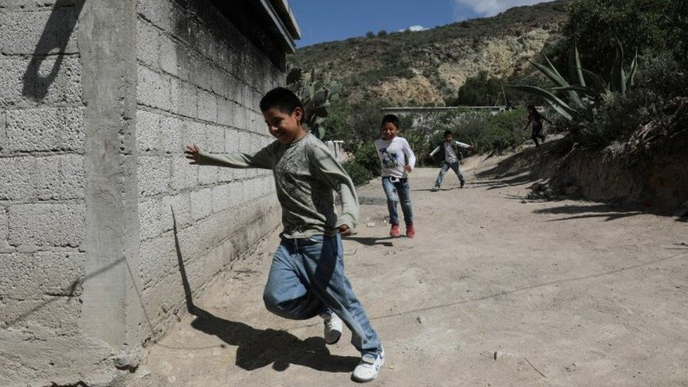 Children run home to follow a televised class as millions of students returned to classes virtually after schools were ordered into lockdown in March, due to the coronavirus disease (COVID-19) outbreak, in Chilcuautla, Hildalgo state, Mexico August 24, 2020.