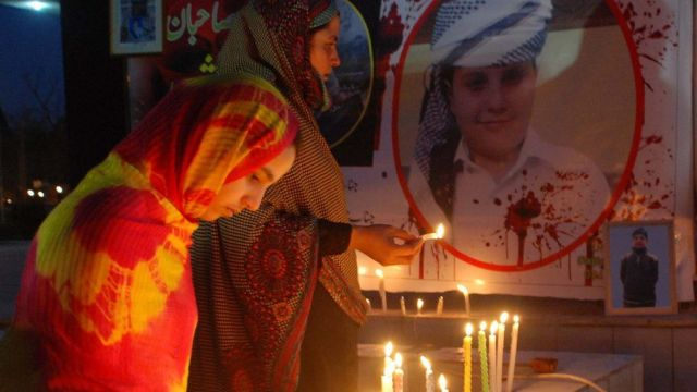 Members of Army Public School Shuhada Forum light candles in commemoration of martyrs of the tragic Army Public School shootings at Aman Chowk on April 16, 2015 in Peshawar, Pakistan.
